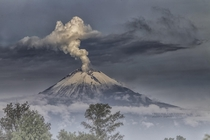 The smoking Popocatepetl volcano in Mexico  by Cristobal Garciaferro Rubio