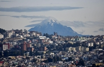 The snow-capped Cotacachi volcano rises above Quito Ecuador