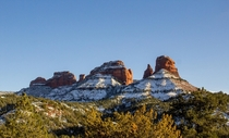 The snow covered monolithic red rocks of Sedona on Boxing Day