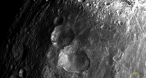 The snowman craters of Vesta the second-largest asteroid in our Solar System