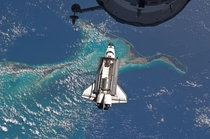 The space shuttle Atlantis flying over the Bahamas on its way to the ISS  Credit NASA