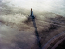 The Space Shuttle Challenger rolls through the fog toward the launch pad at Cape Canaveral November