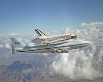 The Space Shuttle Discovery piggy-backing on a modified Boeing  Shuttle Carrier on the way to Kennedy Space Center Florida in   Credit NASALori Losey