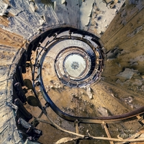 The spiral staircase of an abandoned grand hotel  by Andy Schwetz