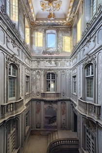 The stair hall of a derelict palace  by Benjamin Wiener