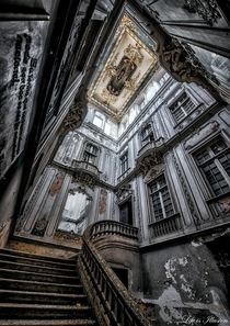 The stair hall of a derelict palace in Lisbon Portugal  By Kwolas Forest