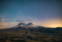 The Stars out with Mount St Helens illuminated by the fading moonlight I believe thats Saturn just rising up on the left
