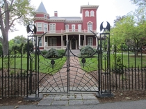 The Stephen King Home - Bangor Maine - Eye-catching red Victorian-style mansion featuring bats spiders and a web on its front gates - Soon to be a writers retreat and an archive of the famous horror authors work