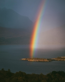 The strongest rainbow Ive ever seen cutting through Torridon Scotland