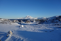 The suburbs of Nuuk Greenland with the Sermitsiaq mountain in the back