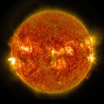 The sun emits an M flare seen on the left August
