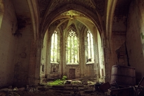 The sun illuminates an abandoned and overgrown church strewn with debris  By Lauric Gourbal Photographies