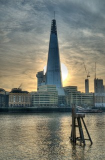 The Sun passing behind The Shard London
