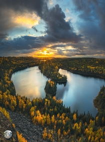The sun peeking down on peak fall colors in the BWCA Minnesota on the left Canada on the right  keefography