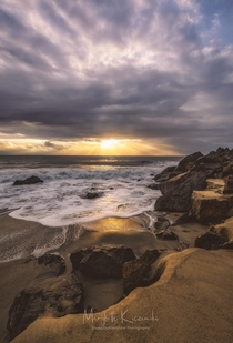 The sun peeking through the overcast skies in Malibu CA Created a small window of some nice light