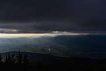 The sun piercing through the clouds from Pilchuck mountain in WA OC x