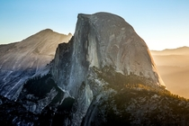 The sun rises over the Half Dome in Yosemite CA  By Stephen Moehle