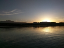 The sun rising over Arizonas lake Roosevelt