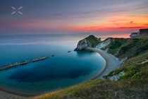 The Sun Sets on Beautiful Man of War Bay on the Dorset coast in England Photographer is SiewLam Wong
