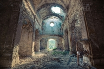 The sun streams into the ruins of a church  Photographed by Oriol Ribera