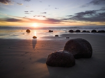 The sunlight hitting the Moeraki Boulders juuust right -