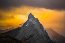 The sunset burning through the clouds behind Mt Wintour in Kananaskis Alberta Canada