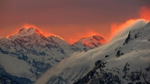The sunset illuminates the mountains peaks near the St Moritz Swiss mountain resort on January  By Arnd Wiegmann