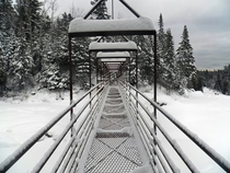 The Superior Hiking Trail suspension bridge over the Baptism River Tettegouche State Park MN