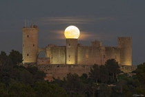 The supermoon over the Spanish Castle Its as if the moon is attached to it CreditNASA