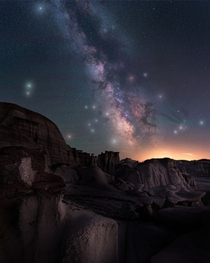 The surreal eroded rock formations of the Bisti Badlands under the Milky Way De-Na-Zin wilderness New Mexico