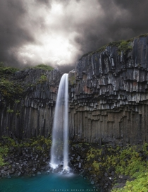 The Svartifoss Black Fall cutting through dark lava columns in south Iceland  photo by Jonathan Besler