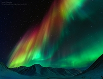 The Symphony of Northern Lights Photo by Tom Charoensinphon