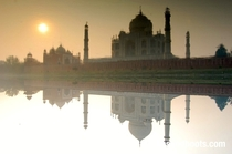The Taja Mahal reflecting in the River Yamuna Agra India