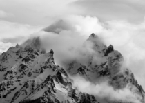 The Teton Massif Engulfed in Clouds - Grand Teton National Park  by justingriggs