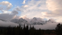 The Tetons play hide and seek in the clouds