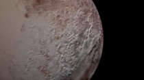 The texture of Pluto in this photo is due to giant spikes of iceNASAJHUAPLSWRI The landscape type which is only found in high-altitude areas around the dwarf planets equator is covered with fields of giant Pentests as tall as the Eiffel tower with peaks l