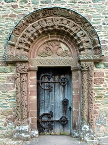 The th Century south door at the small church of St Mary and St David Kilpeck