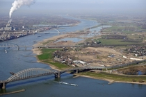 The three bridges of Nijmegen The Netherlands and one in the back near Ewijk On the right the ongoing project Room for the river Waal