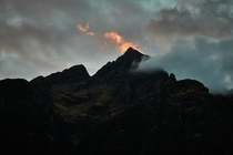The tip is on fire Sunset near Milford Sound Fiordland National Park New Zealand