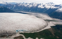The tongue of the absolutely enormous Taku Glacier  Near Juneau AK it has been measured at  feet  m thick about  kilometres  mi long