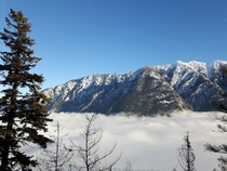 The top of the Highline mountain pass near Seaton Portage BC above the valley fog