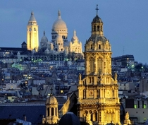 The towers of Montmartre Sacre-Coeur Basilica and the Church of the Holy Trinity