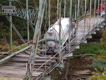 The tragic results when a  ton water truck tried to cross a -year old iron truss Pollocks Mill Bridge Greene County Pennsylvania