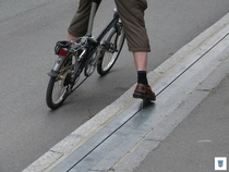 The Trampe bicycle lift in Trondheim Norway A pedal on the road that goes up a hill pushing cyclists