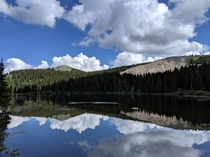 The trees and reflection come together like a soundwave Married here in August  Alta Lakes Ophir CO Reservoir