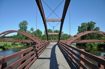 The Tridge - a three-way wooden footbridge spanning the confluence of the Chippewa and Tittabawassee Rivers in Chippewassee Park