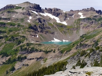 The turquoise coloured Goat Lake sits in a small steep basin in Goat Rocks Wilderness Washington