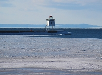 The Two Harbors MN harbor entrance light house and breakwater Two Harbors MN