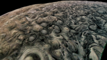 The uneven stormy surface of Jupiter