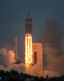 The United Launch Alliance Delta IV Heavy rocket with NASAs Orion spacecraft mounted atop lifts off from Cape Canaveral Air Force Stations Space Launch Complex  at at  am EST Friday Dec   in Florida